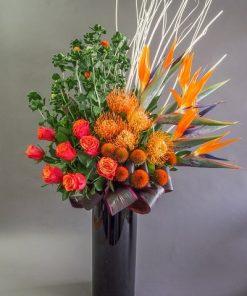 roses and pin cushion black vase arrangement