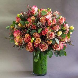 rustic roses table flower arrangement